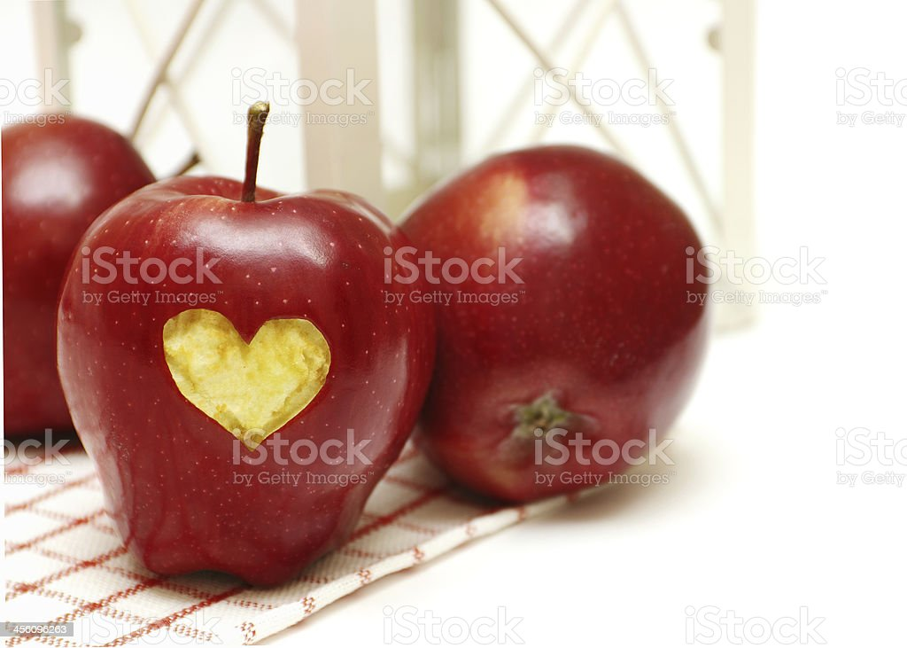 Apples with heart on the napkin stock photo