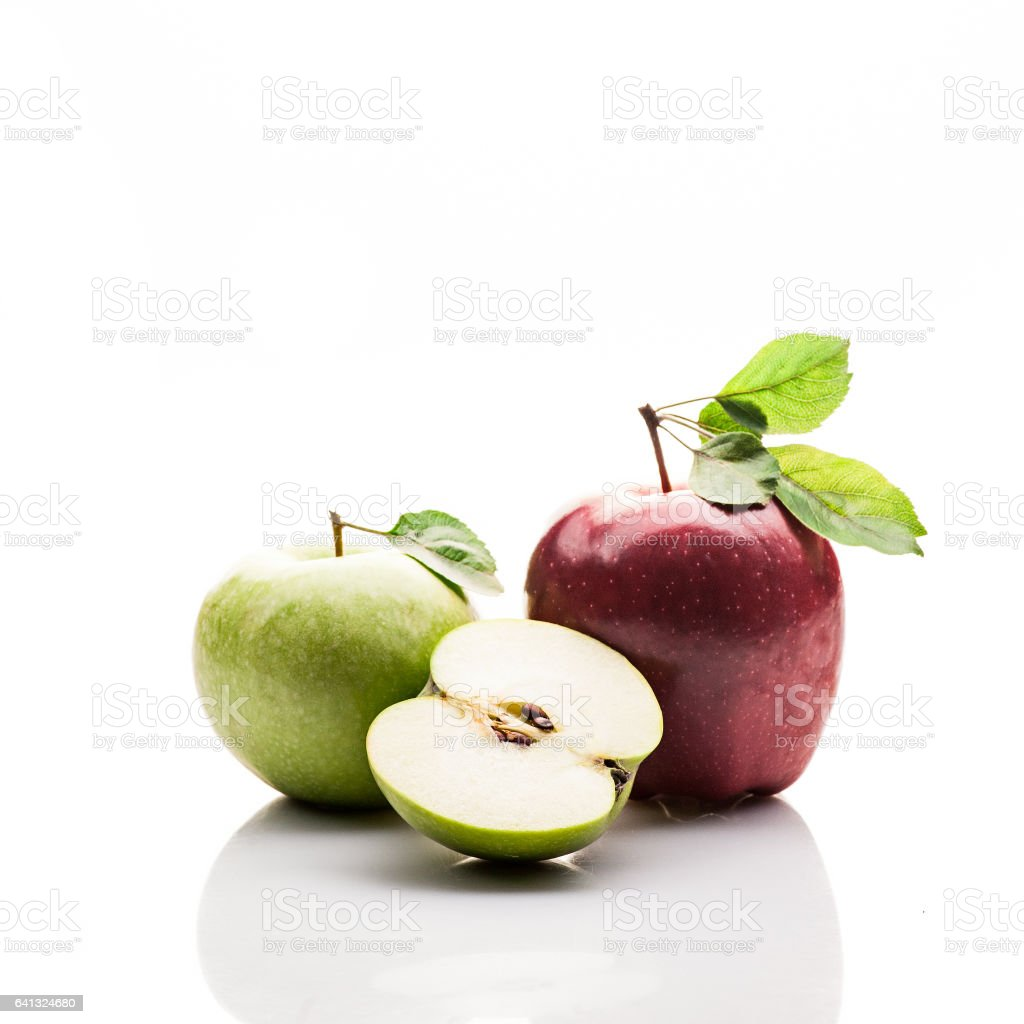 apples. with lives. red, green and sliced. isolated on white. stock photo