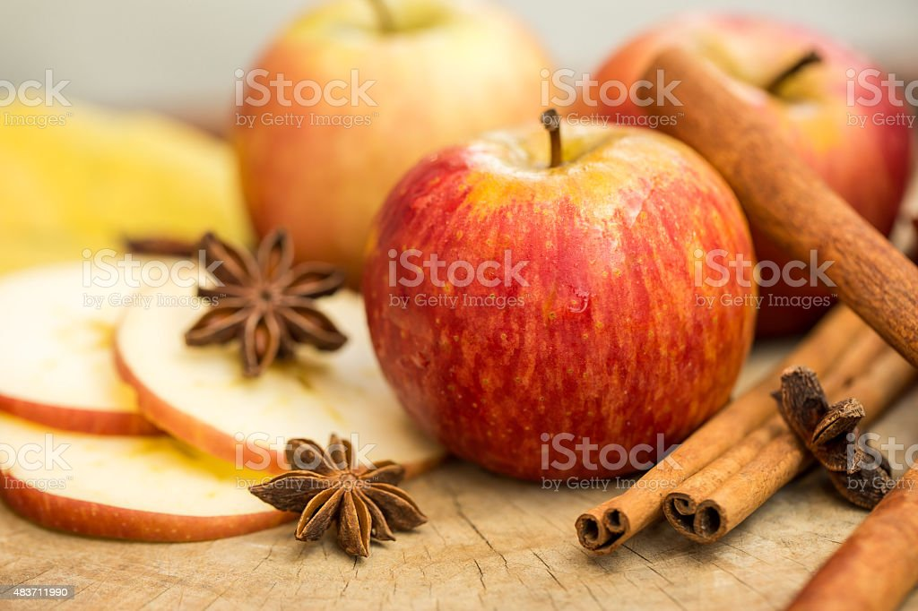 Apples with star anise. Autumn composition with leaves and apples. stock photo