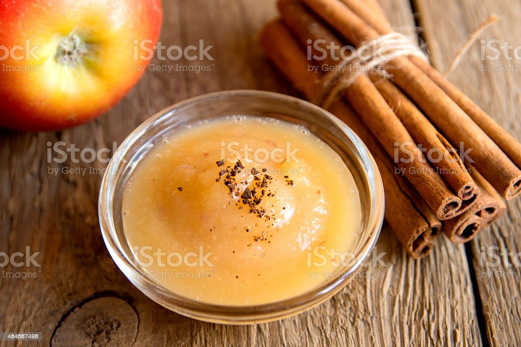 applesauce with cinnamon stock photo