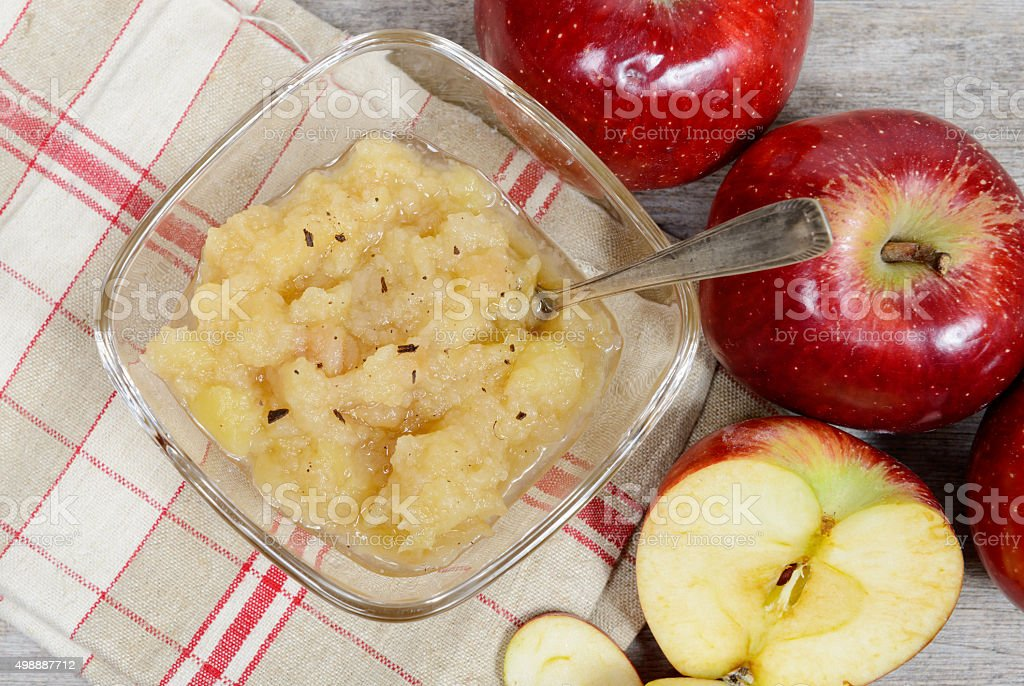 applesauce with some apples stock photo