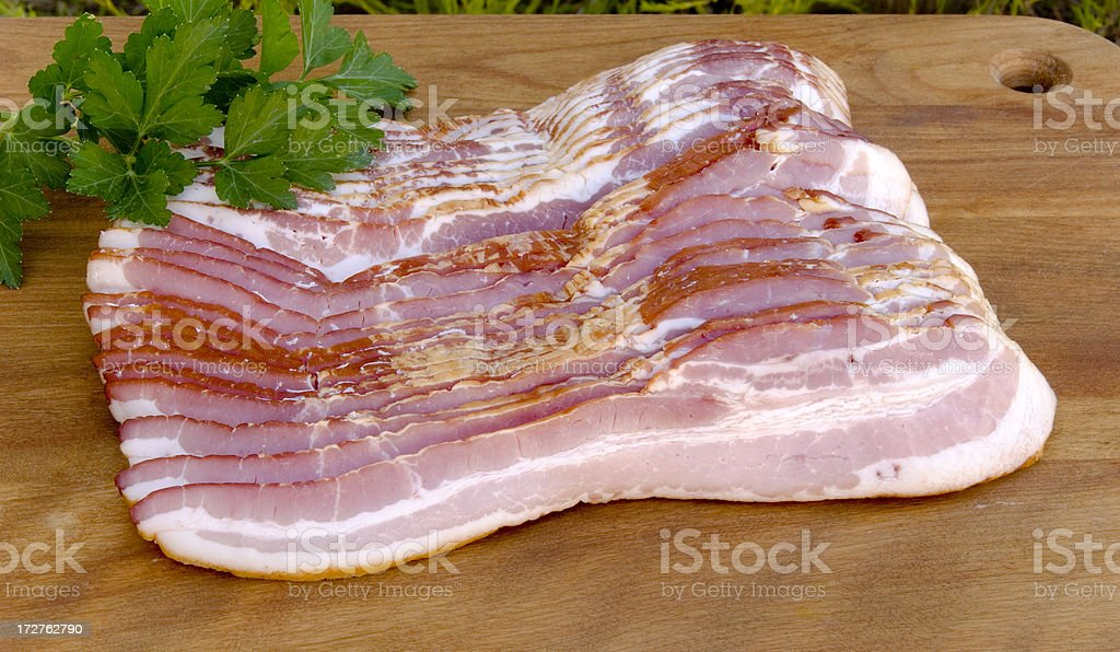 Applewood Smoked Meat, Sliced Pork Bacon royalty-free stock photo