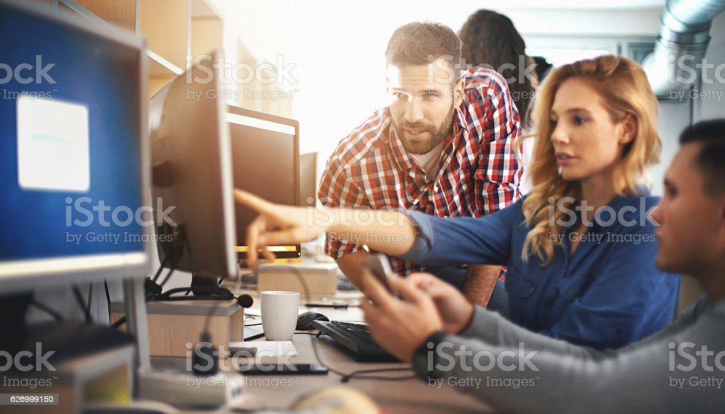 Application developers at work. stock photo
