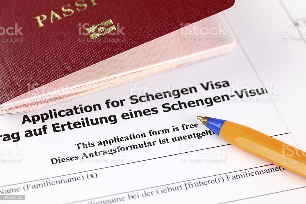 'Application for Schengen visa, passport and pen.' stock photo