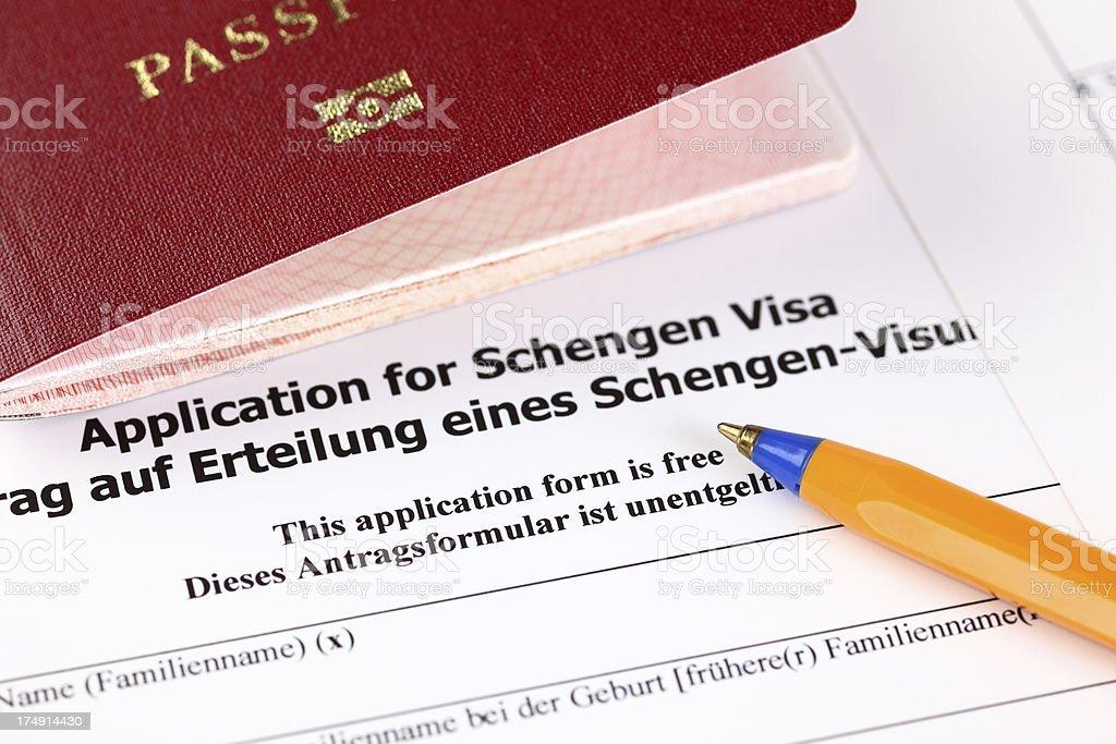 Application for Schengen visa, passport and pen. stock photo