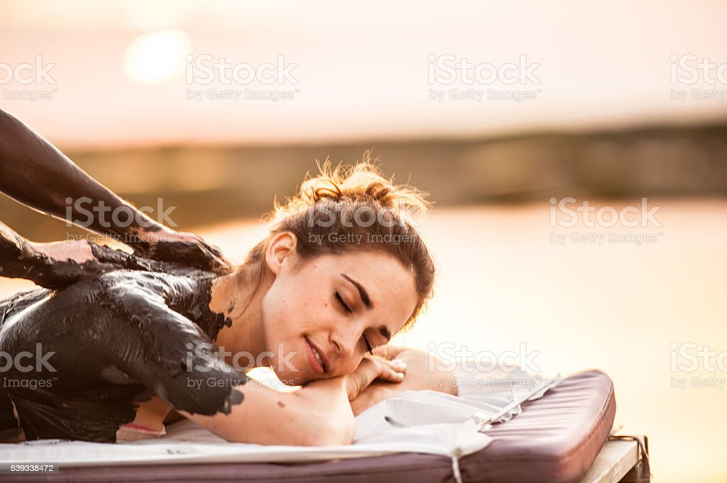 Application Mud Wrap in Outdoors SPA stock photo