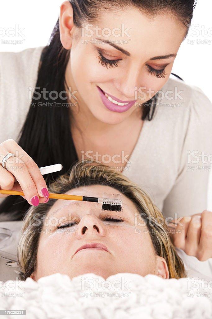 Application of false eyelashes royalty-free stock photo