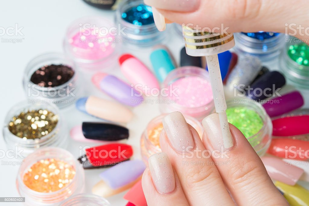 application to the nails girls stock photo