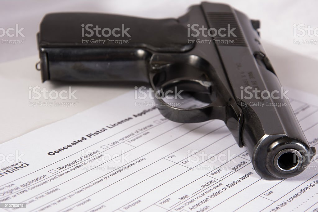 CCW Application with small 9mm handgun stock photo