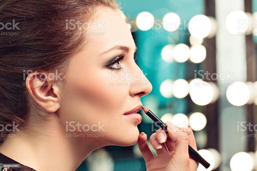 Appling lip liner stock photo