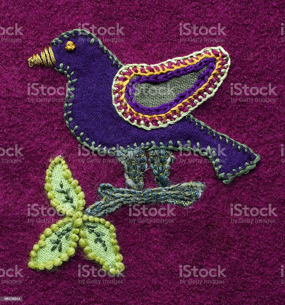 Applique and embroidered bird stock photo