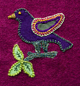 Applique and embroidered bird