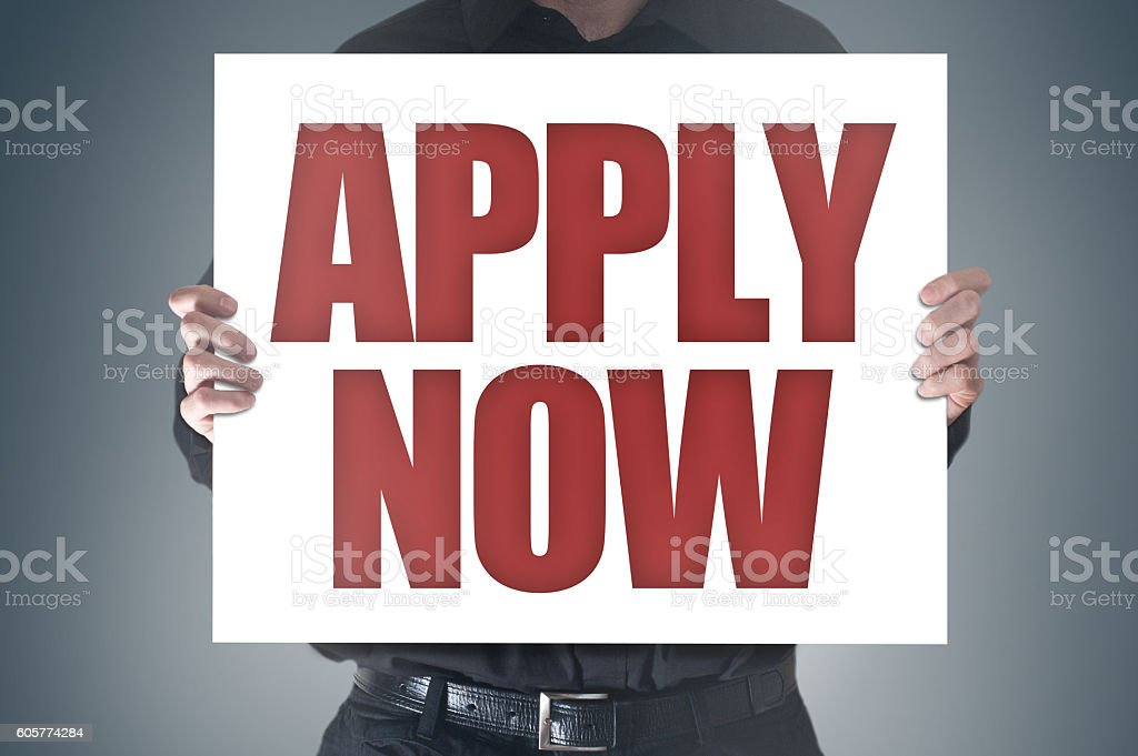 Apply now / Businessman holding panel (Click for more) stock photo