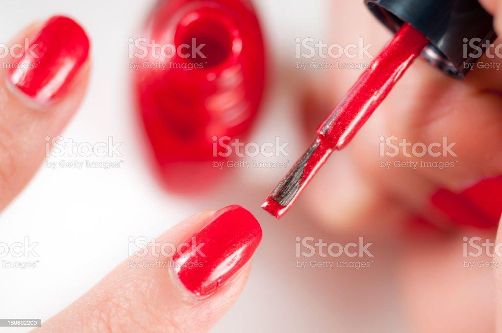 Apply Red Nail Polish stock photo