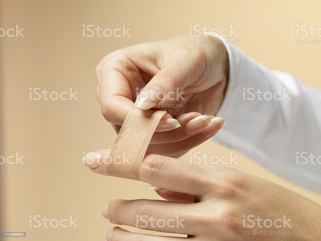 Applying a band-aid royalty-free stock photo