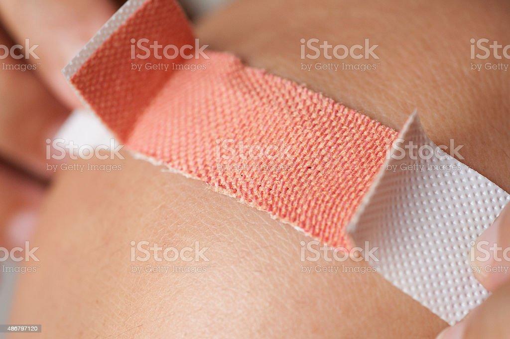 Applying adhesive bandage stock photo