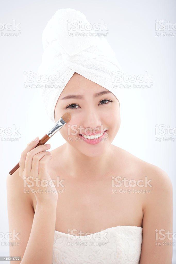 Applying concealer stock photo