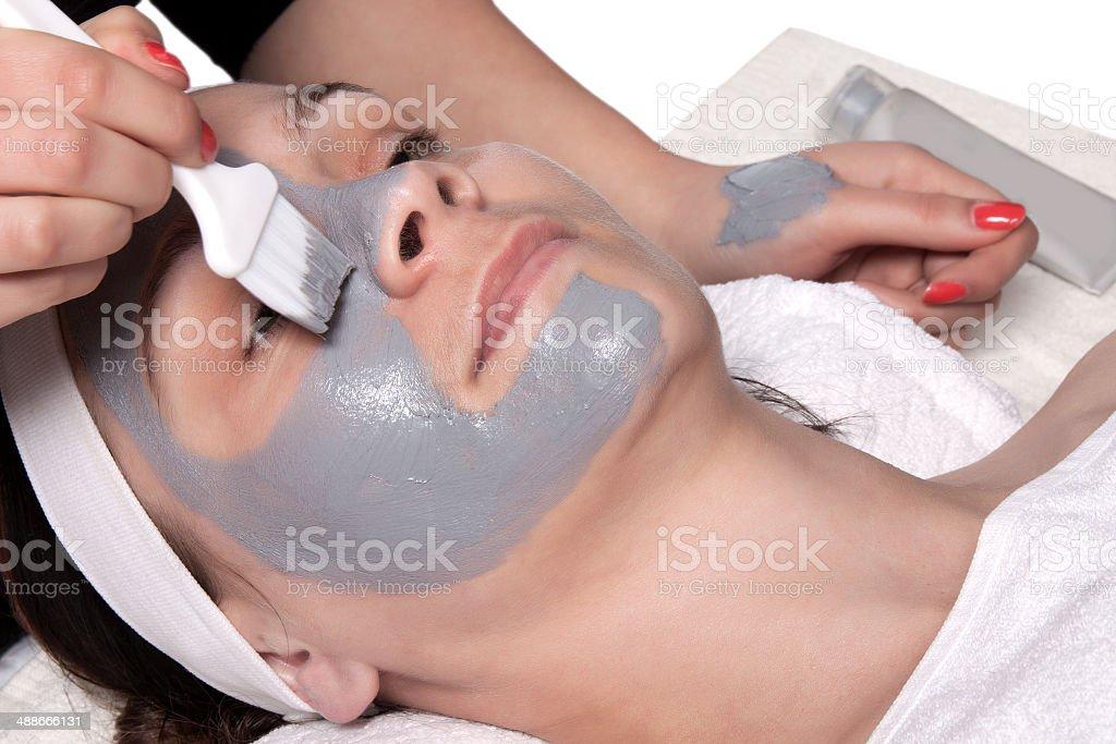 Applying cosmetic mask stock photo