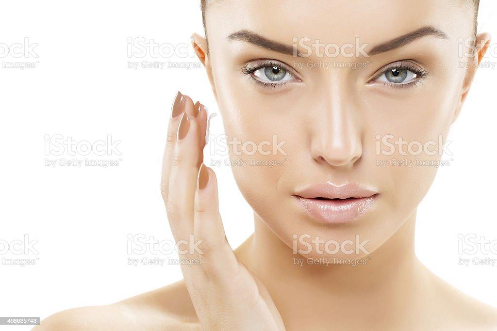 applying cream woman stock photo