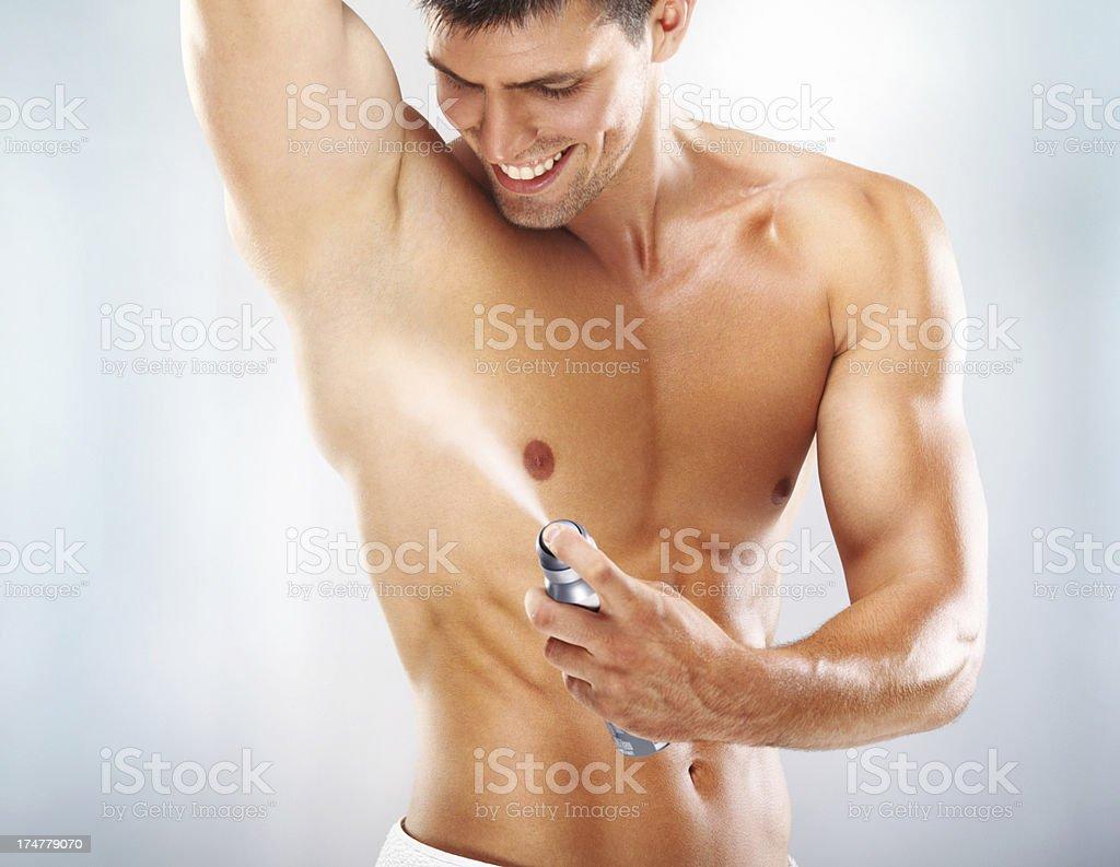 Applying deodorant. stock photo