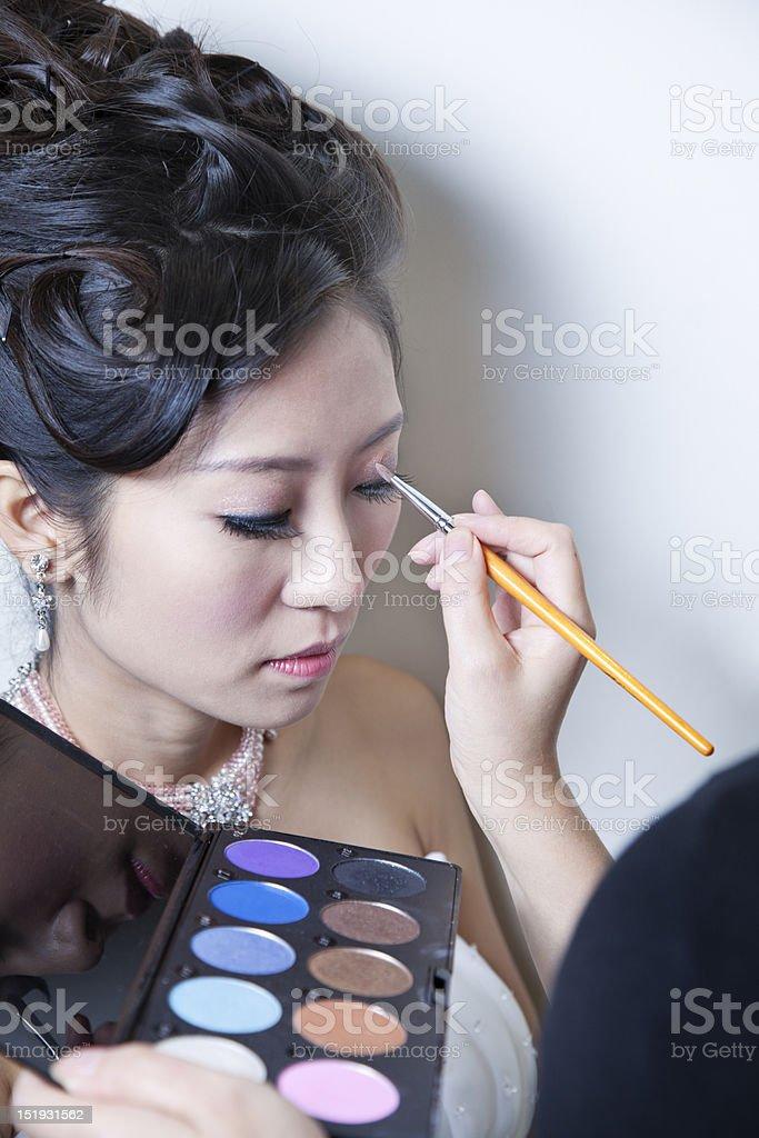 Applying eyeshadow. royalty-free stock photo