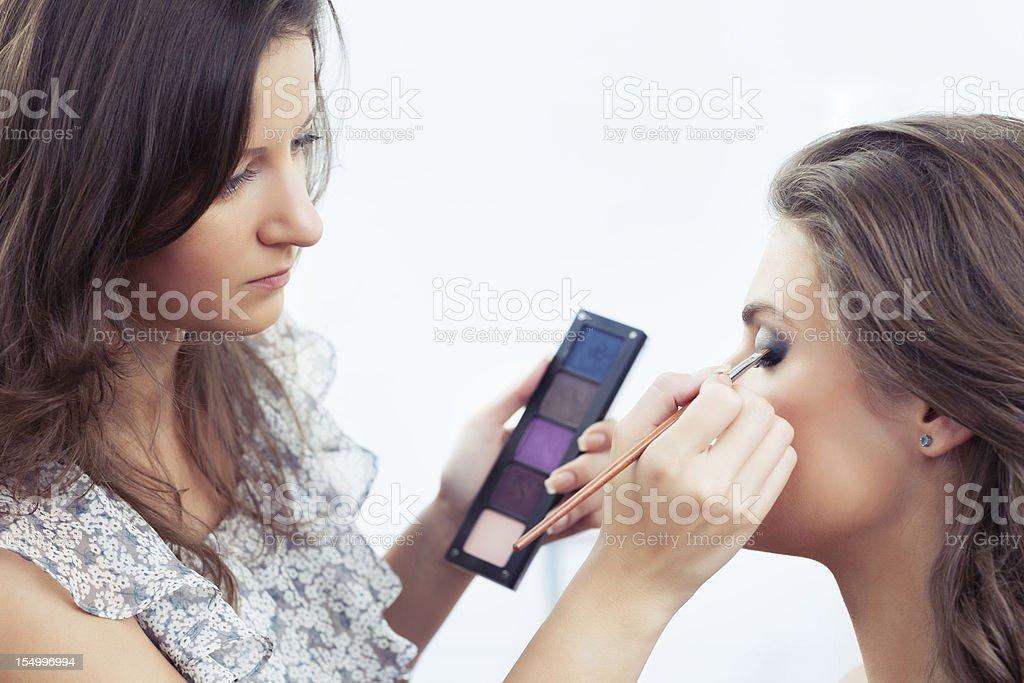 Applying eyeshadow royalty-free stock photo