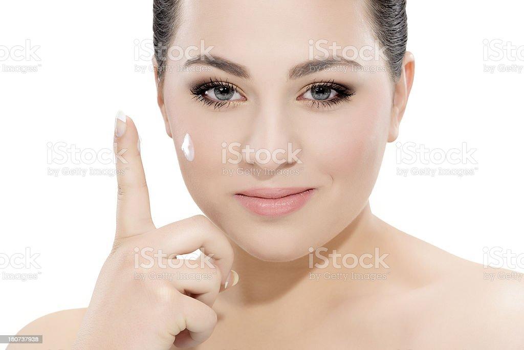 applying face cream royalty-free stock photo