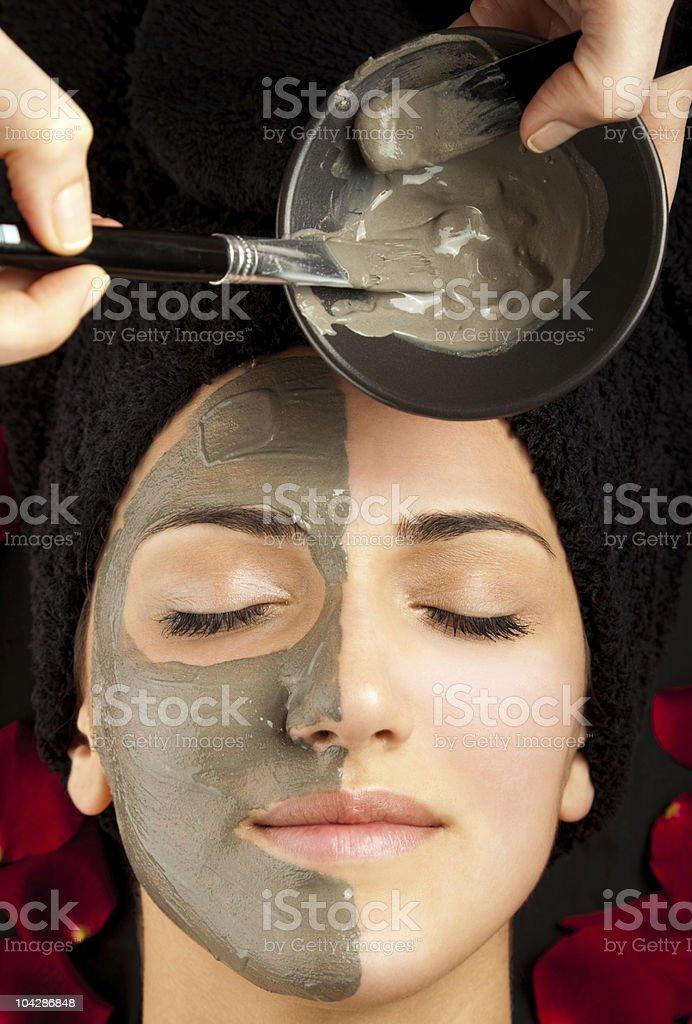 applying facial mask royalty-free stock photo
