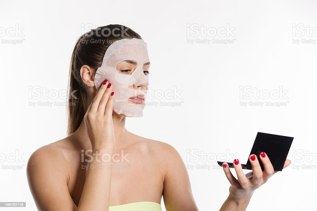Applying facial mask stock photo
