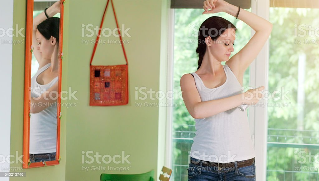 Applying Fragrance stock photo