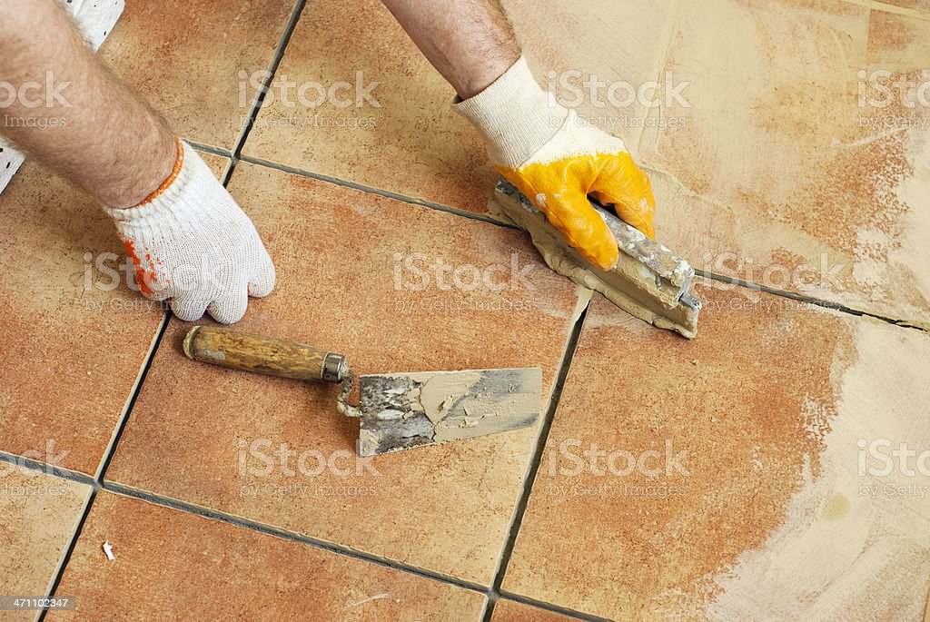 Applying grout royalty-free stock photo
