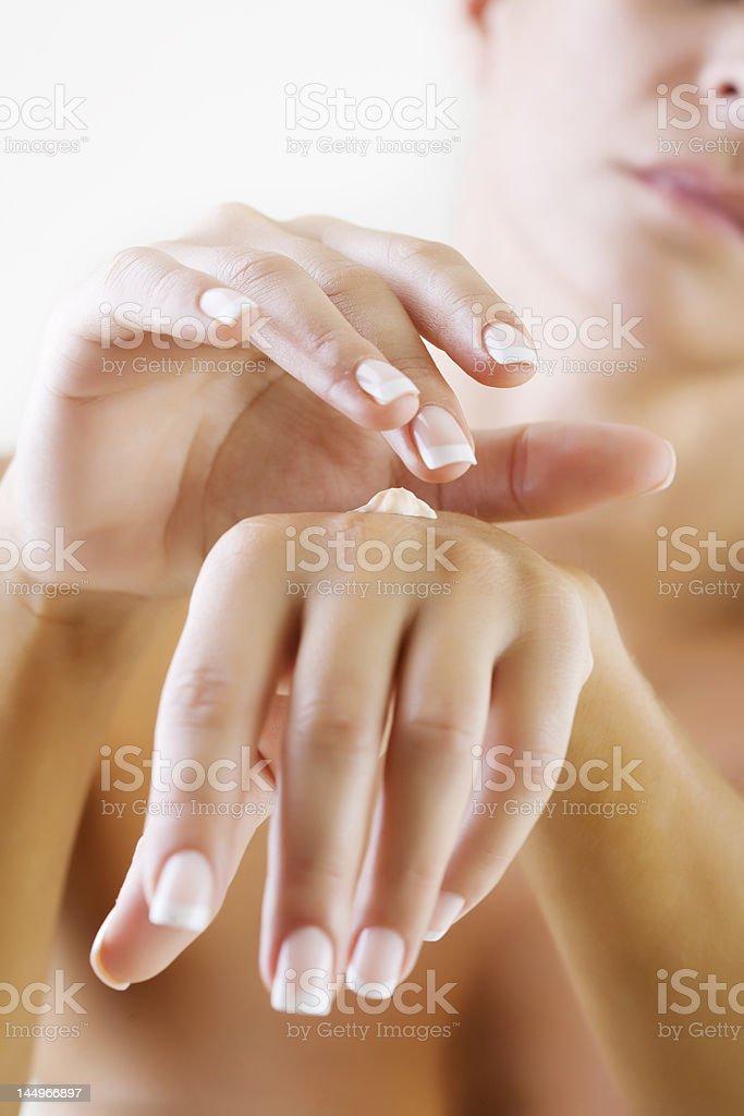 applying hand lotion stock photo