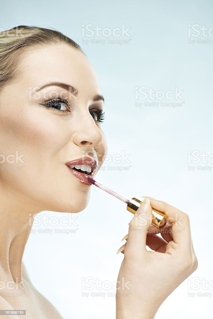 Applying her lipstick royalty-free stock photo