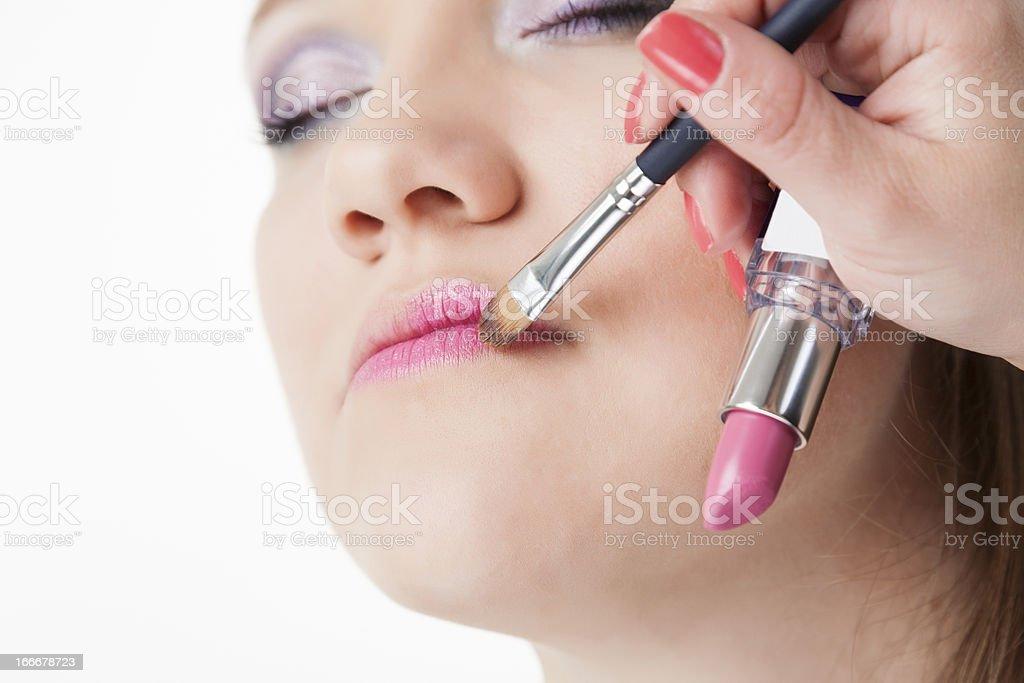 Applying Lipstick royalty-free stock photo