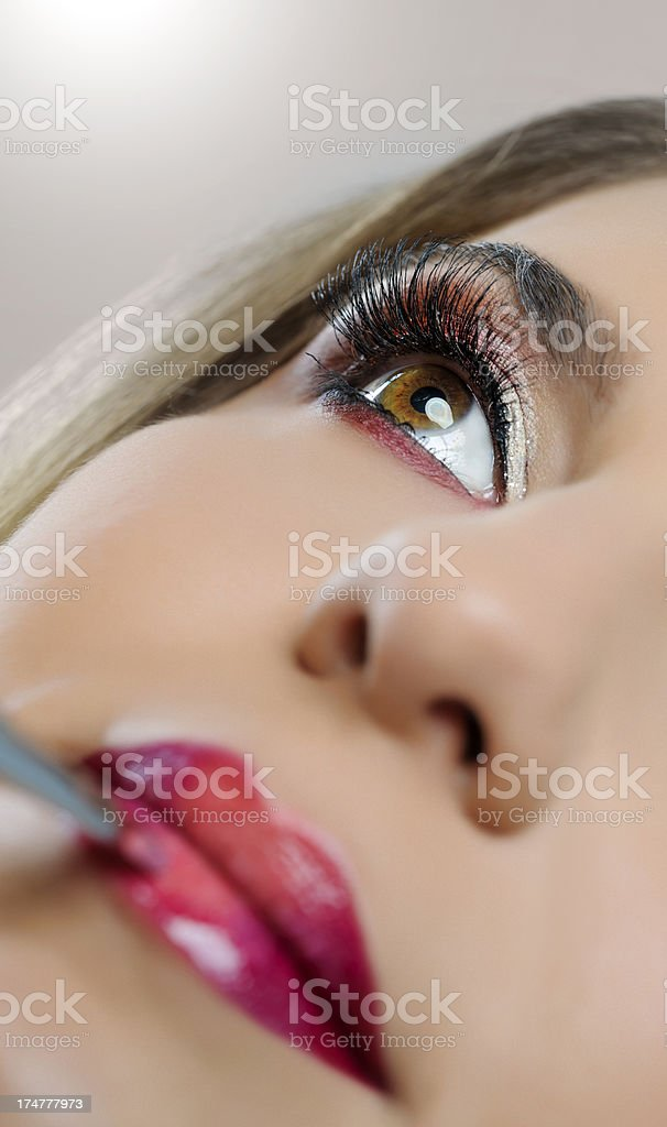 applying lipstick royalty-free stock photo