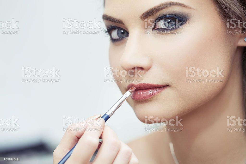 Applying lipstick stock photo