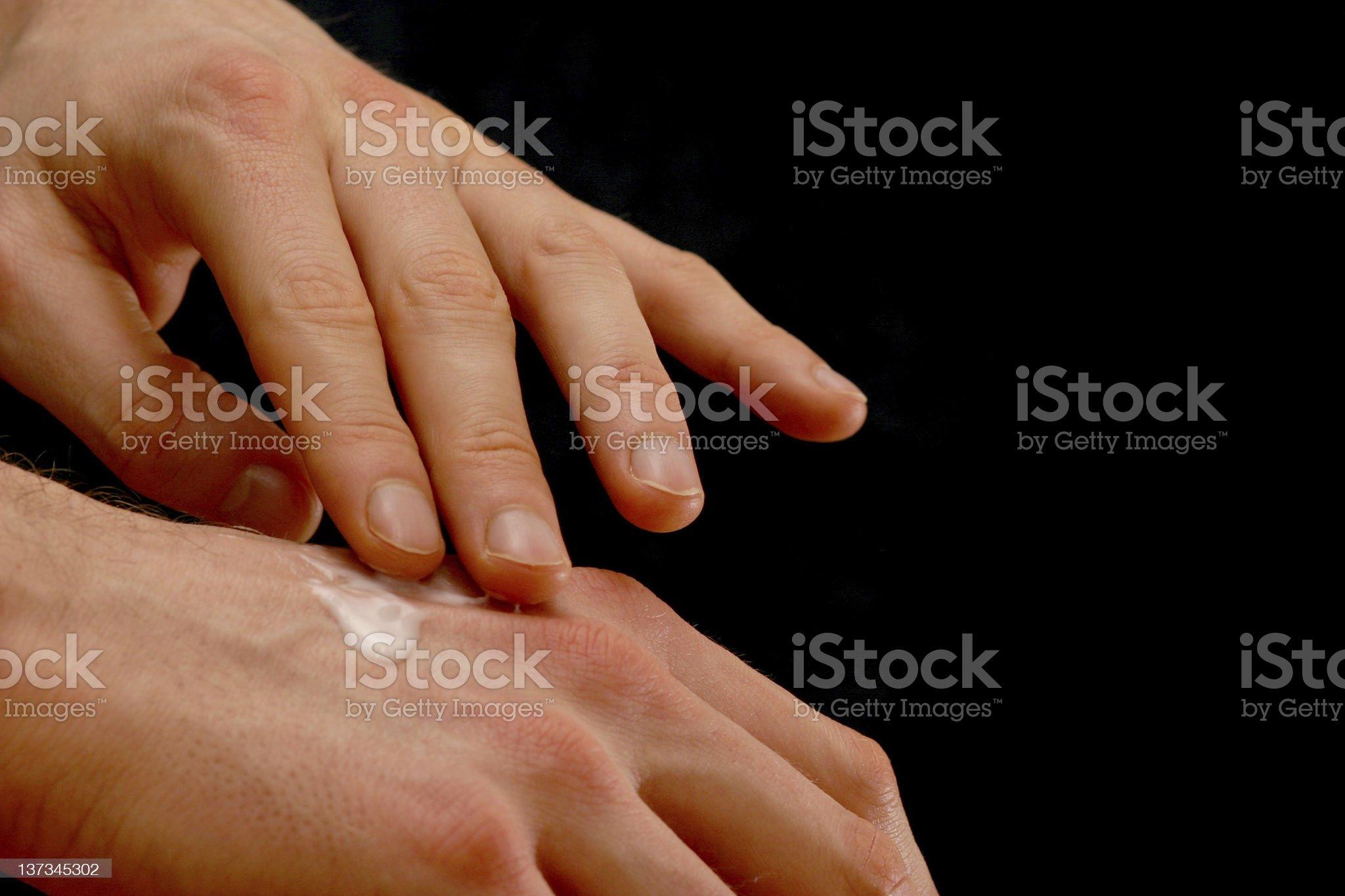 Applying lotion royalty-free stock photo