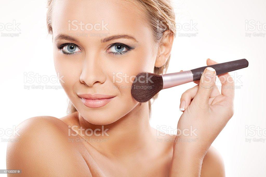 Applying make up on beautiful face royalty-free stock photo