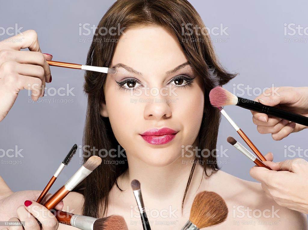 Applying make up royalty-free stock photo