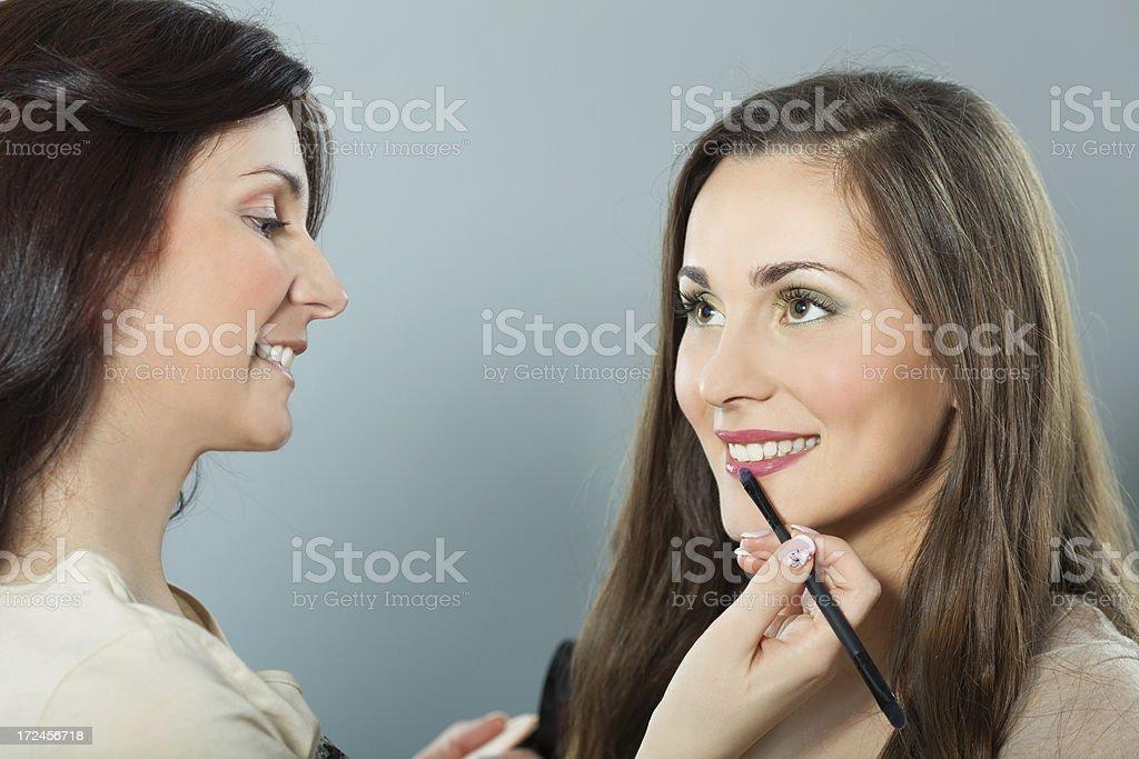 Applying make-up royalty-free stock photo