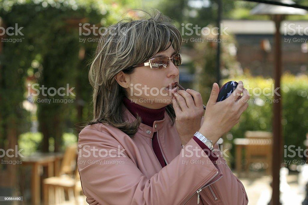 Applying makeup royalty-free stock photo
