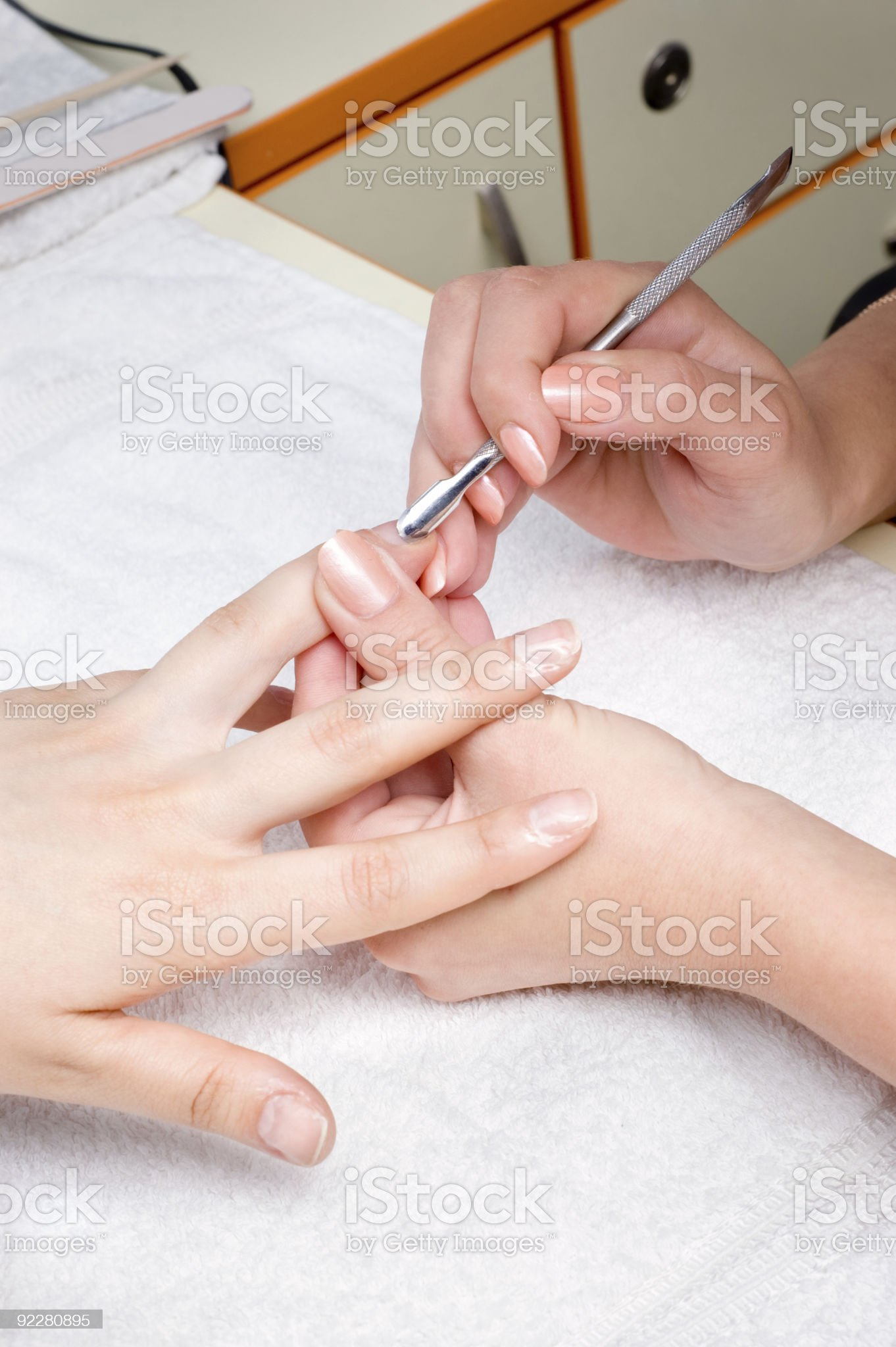 applying manicure - cuticle cleaning royalty-free stock photo