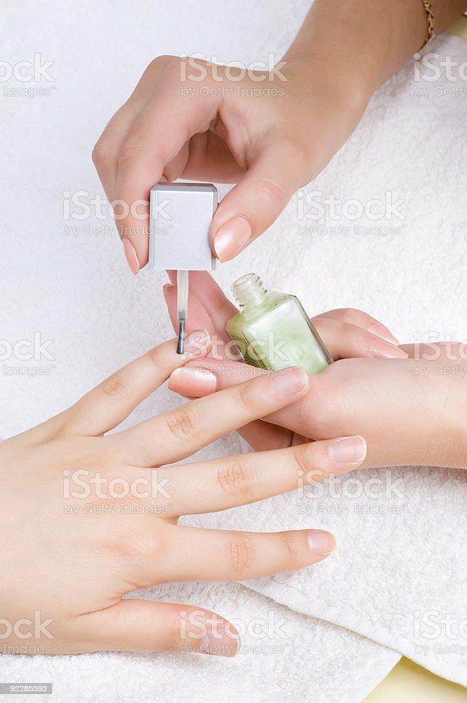 applying manicure, moisturizing the nails royalty-free stock photo