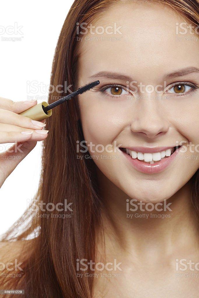 Applying mascara stock photo