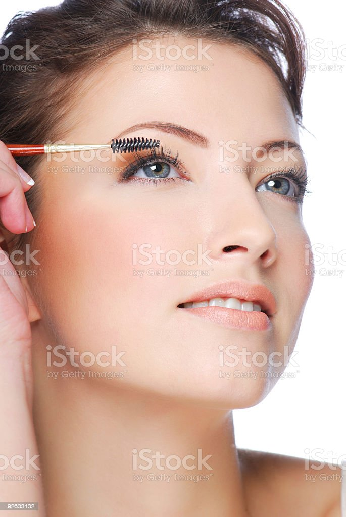 applying mascara using lash brush stock photo