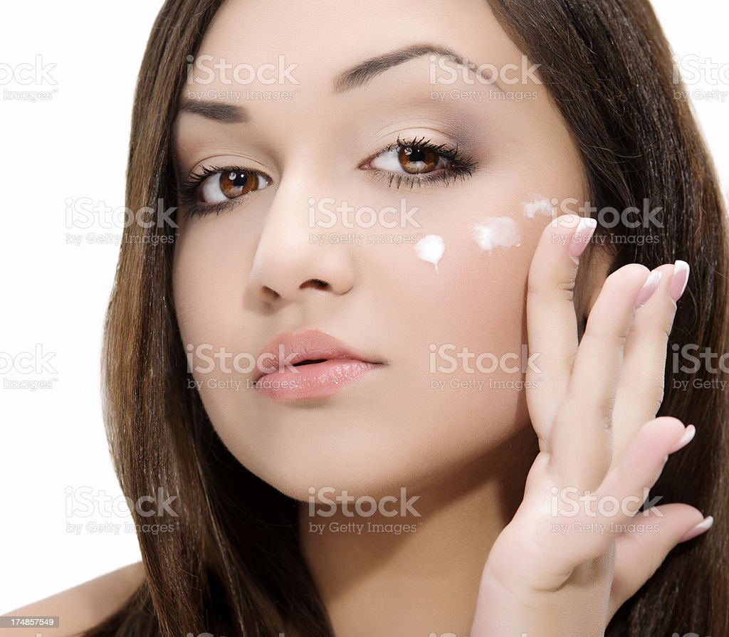 applying moisturizer royalty-free stock photo