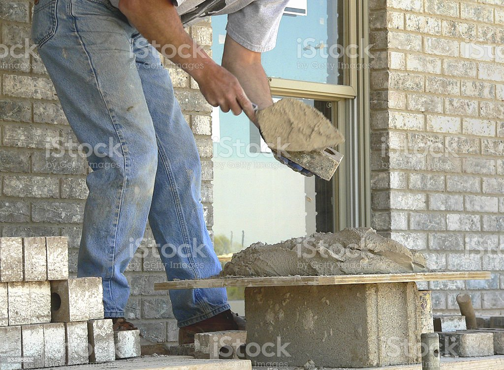 Applying Mortar stock photo