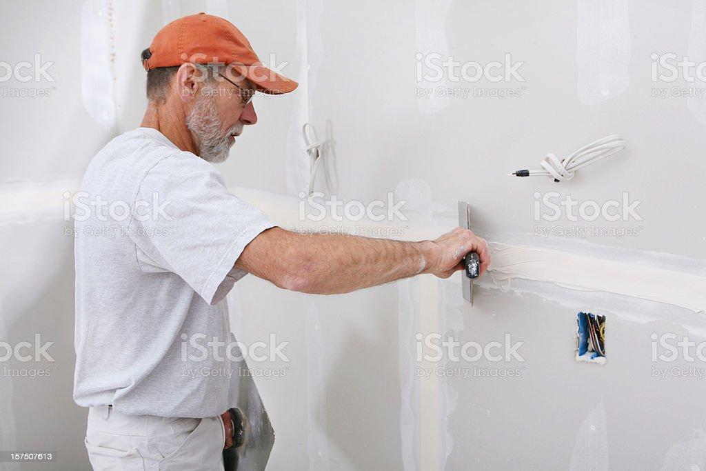 Applying Mud to Sheetrock stock photo