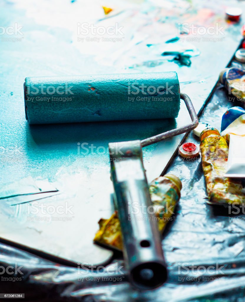 Applying paint with a roller in estampas workshop stock photo
