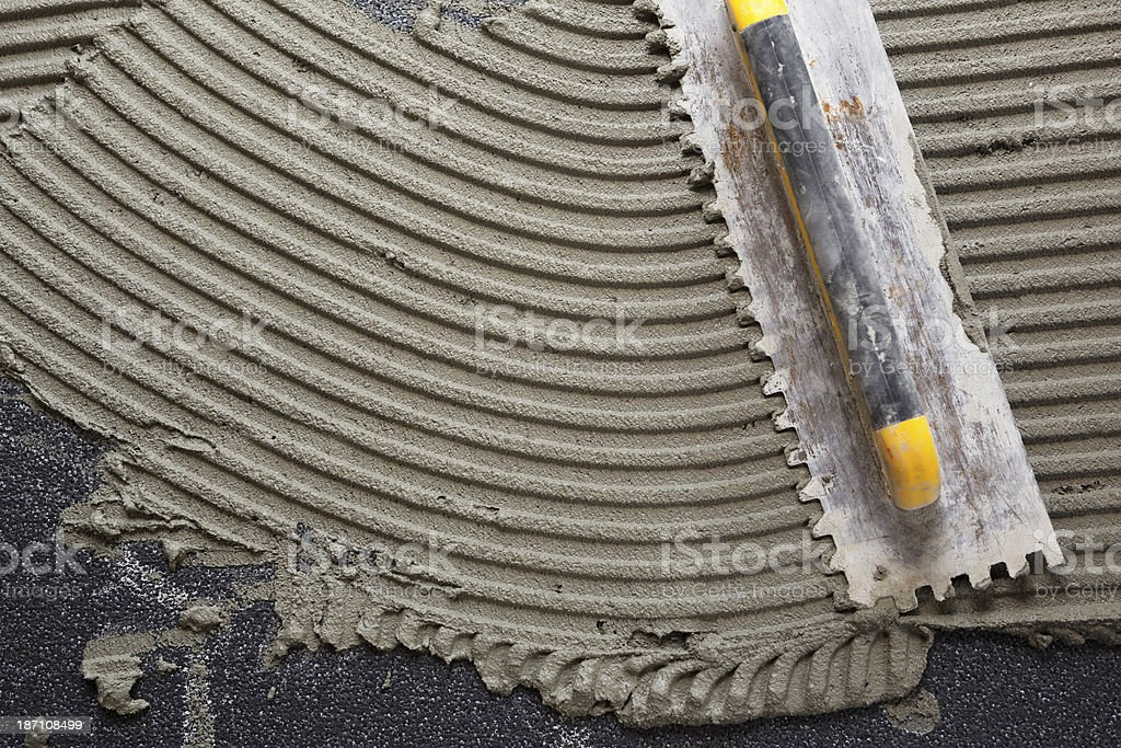 Applying Plaster on EPS stock photo